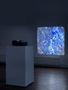 Pieter Paul Pothoven, Lapis Lazuli from Serr-i-Sang, 2012 – 2015, series no. 4/7, 4 slices of lapis lazuli mounted on glass, Leica slide projector, pedestal (installation view at PuntWG, Amsterdam)